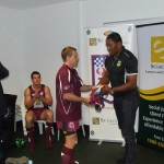 QLD POLICE V NSW POLICE 2014 ANDREW CRIDLAND RECEIVING HIS JERSEY FROM PETERO CIVONICEVA
