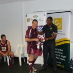 QLD POLICE V NSW POLICE 2014 CAPTAIN BEN SAWDEN RECEIVING HIS JERSEY FROM PETERO CIVONICEVA